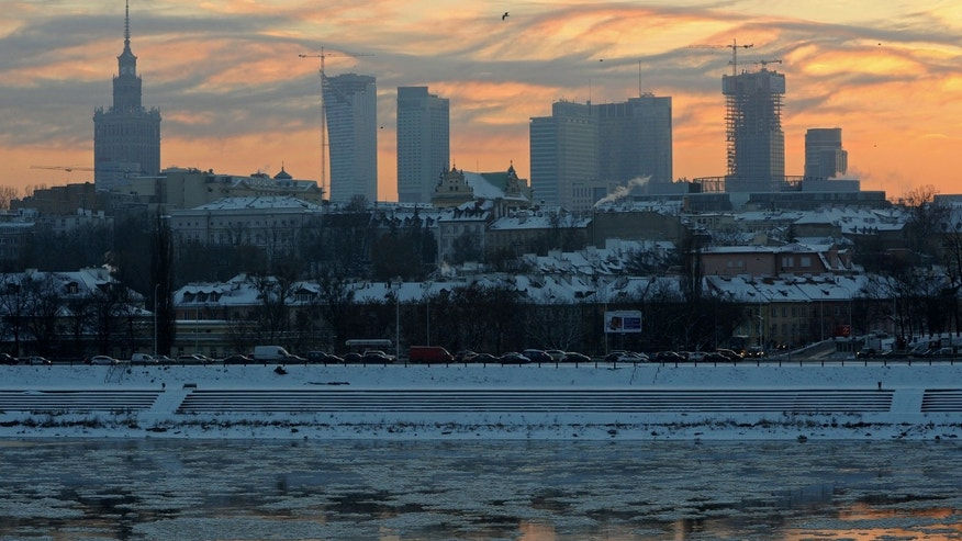Dec. 21, 2012 -Warsaw's skyline is reflected in the icy Vistula river as sun sets after another freezing day, with temperatures reaching minus 10 degrees.