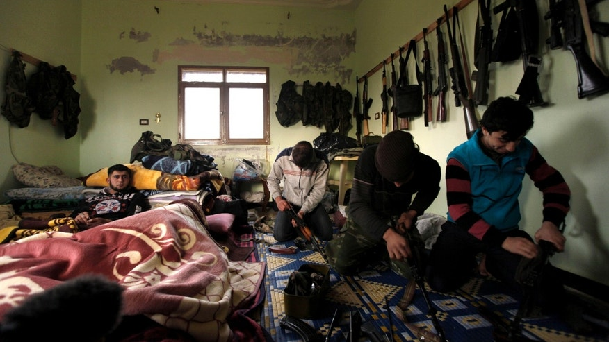 Dec. 12, 2012 - Syrian rebels clean their weapons at their headquarters in Maaret Ikhwan, near Idlib, Syria.