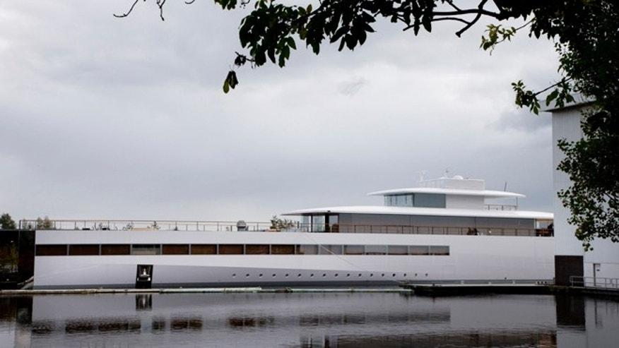 The sleek, white superyacht Apple founder Steve Jobs commissioned before his death cannot leave the Netherlands just yet due to a payment dispute. Dutch newspaper Het Financieele Dagblad reported Friday Dec. 21, 2012 that Starck hired a debt collection agency and got a summary legal order to keep the boat from leaving.