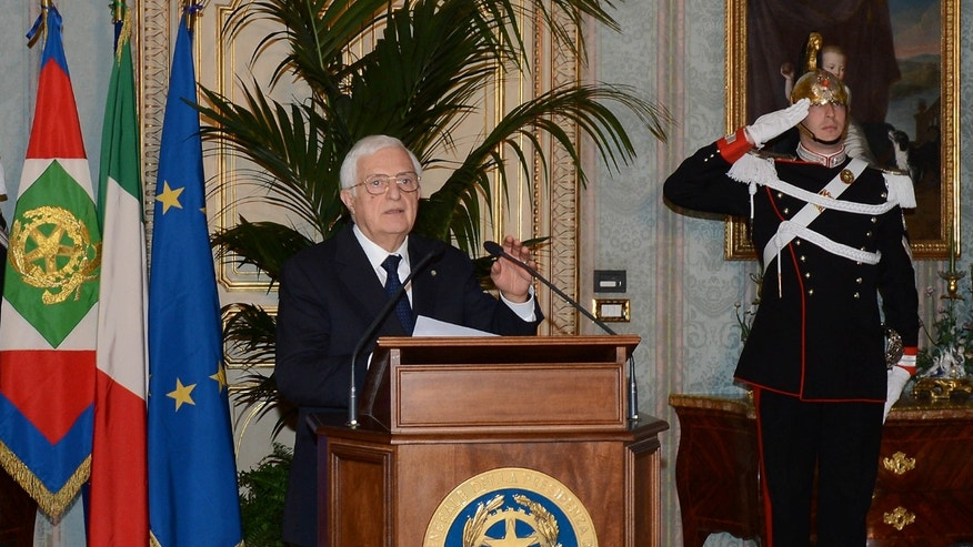 In this photo released by the Italian Presidency, the general secretary Donato Marra officially announces the resignation of Mario Monti at the Quirinale presidential palace in Rome Friday, Dec. 21, 2012. Mario Monti handed in his resignation to Italy's president in Rome on Friday, bringing to a close his 13-month technical government and preparing the country for national elections. President Giorgio Napolitano -- who tapped Monti in November 2011 to come up with reforms to shield Italy from the continent's debt crisis -- asked Monti to stay on as head of a caretaker government until the national vote, expected in February. (AP Photo/Antonio Di Gennaro, Italian Presidency ho)