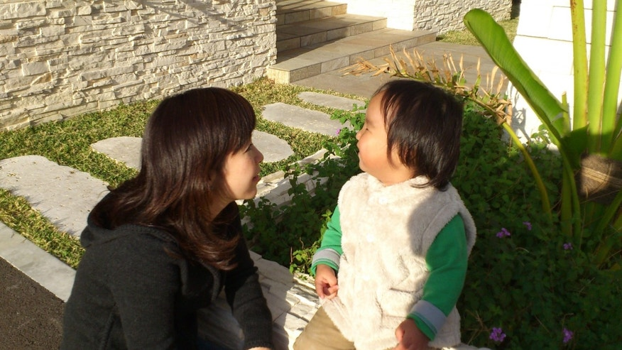 "In this photo released by Minako Kubota, Kubota chats with her two-year-old son in Naha, Okinawa, Japan. Okinawa is about as far away as one can get from Fukushima without leaving Japan, and that is why Kubota is here. Petrified of the radiation spewing from the Fukushima Dai-ichi nuclear plant that went into multiple meltdowns last year, Kubota grabbed her children, left her skeptical husband and moved to the small southwestern island. More than a thousand people from the disaster zone have done the same thing. ""I thought I would lose my mind,"" Kubota told The Associated Press in a recent interview. ""I felt I would have no answer for my children if, after they grew up, they ever asked me, ""Mama, why didn't you leave?"" (AP Photo/Courtesy of Minako Kubota)"