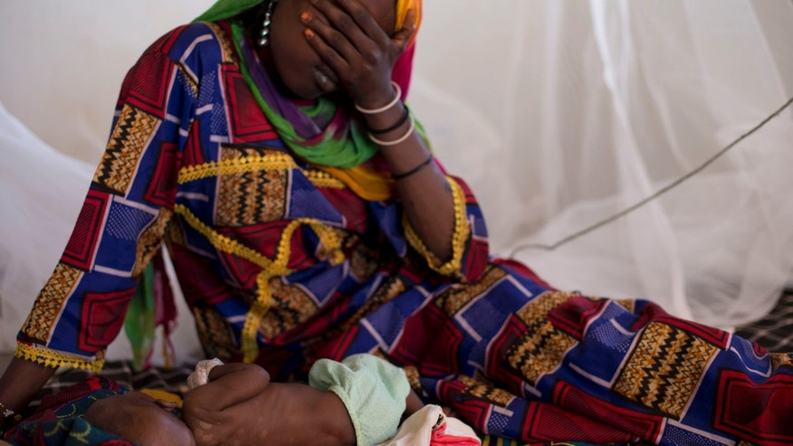 ADVANCE FOR SATURDAY DEC 22, 2012 In this Oct. 31, 2012 photo, Harmata Mahamat reacts as she sits with her daughter Halime, 3 months, at a local nutrition clinic where Halime was being treated for malnutrition, in Nokou in the Mao region of Chad. Halime died several days later. In this Sahel nation, childhood malnutrition and related mortality persist at alarming rates, despite the fact that most affected families live within a day's journey of internationally-funded nutrition clinics. One reason is that families, bound by local custom, choose instead to seek traditional treatments, treatments which can lead to the very infections that kill their undernourished children.(AP Photo/Rebecca Blackwell) Chad. In this Sahel nation, childhood malnutrition and related mortality persist at alarming rates, despite the fact that most affected families live within a day's journey of internationally-funded nutrition clinics. One reason is that families, bound by local custom, choose instead to seek traditional treatments, treatments which can lead to the very infections that kill their undernourished children.(AP Photo/Rebecca Blackwell)