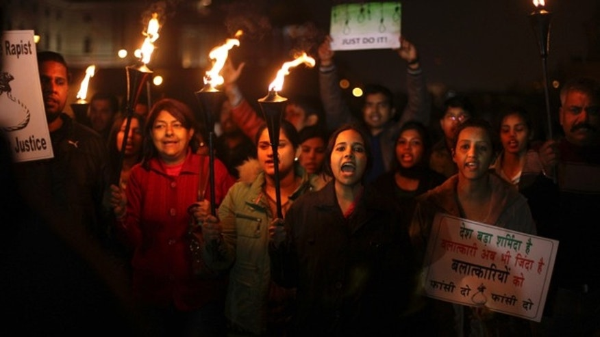 Dec. 22, 2012: Indian protesters shout slogans as they march carrying torches near the Presidential Palace in New Delhi, India.