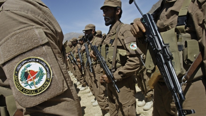April 24, 2011: In this file photo, Afghan Local Police, ALP, listen to a speech during a ceremony presenting new uniforms for ALP at Gizab village of Uruzgan province south west of Kabul, Afghanistan.