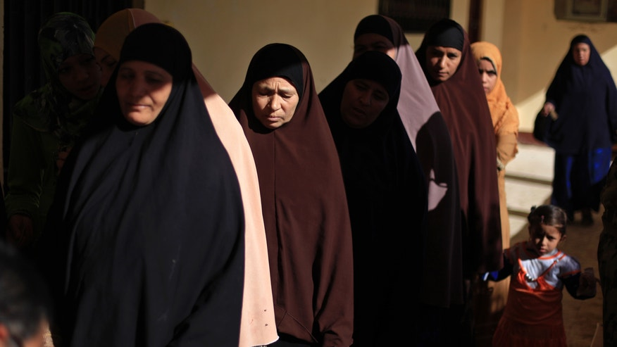 FILE - In this Saturday, Dec. 22, 2012 file photo, Egyptian women line up outside a polling station to cast their votes during the second round of a referendum on a disputed constitution drafted by Islamist supporters of President Mohammed Morsi in Fayoum, about 100 kilometers (62 miles) south of Cairo, Egypt. When election-time rolls around, this impoverished rural province has proven one of Egypt's most die-hard bastions of support for Islamists, handing them lopsided victories. The referendum that approved Egypt's Islamist-backed constitution was no exception, with nearly 90 percent of voters here supporting the charter. But even here, voices of discontent with the Muslim Brotherhood are emerging, something the liberal and secular opposition is hoping to build on in upcoming parliament elections.(AP Photo/Khalil Hamra, File)