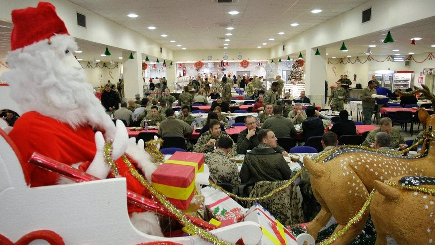 Dec. 25, 2012: Soldiers and service members with the NATO-led International Security Assistance Force (ISAF) eat Christmas dinner at a dining facility at the U.S.-led coalition base in Kabul, Afghanistan.