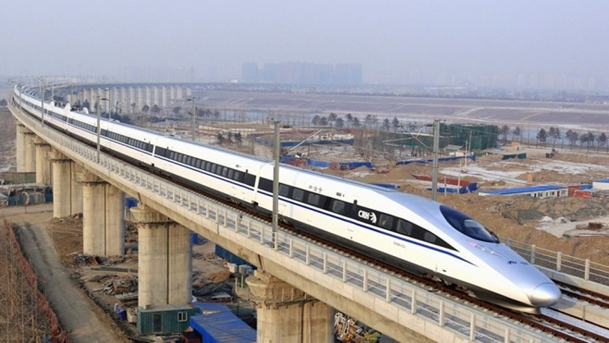 Dec. 26, 2012: A bullet train passes over Yongdinghe Bridge in Beijing. China has opened the world's longest high-speed rail line, which runs 1,428 miles from the country's capital in the north to Guangzhou, an economic hub in the Pearl River delta in southern China.