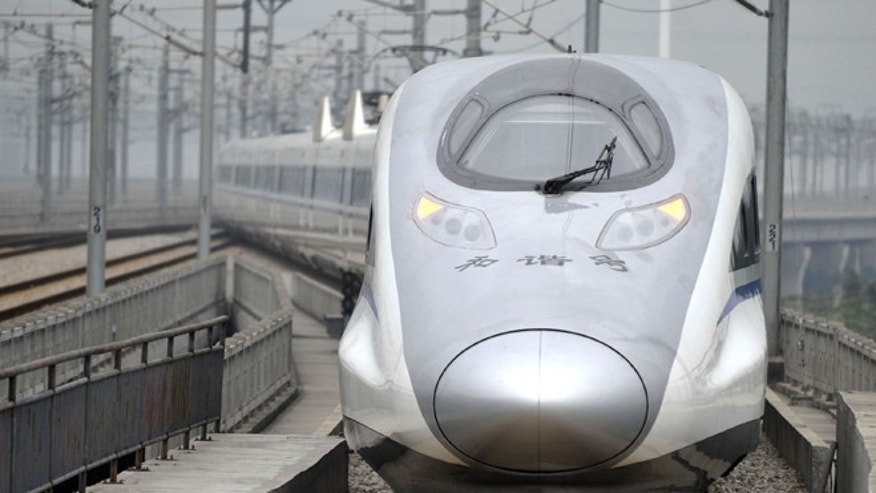 Dec. 26, 2012: A bullet train G80 leaves for Beijing from the Guangzhou South Railway Station in Guangzhou.