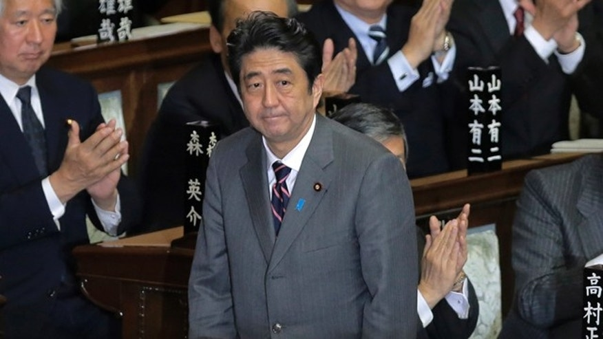 Dec. 26, 2012: Japan's Liberal Democratic Party leader Shinzo Abe acknowledges applause from lawmakers after being named Japan's new prime minister at the lower house of Parliament in Tokyo.