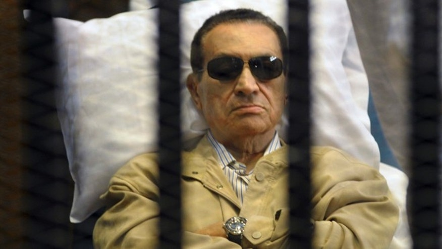 June 2, 2012: In this file photo, Egypt&#39&#x3b;s ex-President Hosni Mubarak lays on a gurney inside a barred cage in the police academy courthouse in Cairo, Egypt.