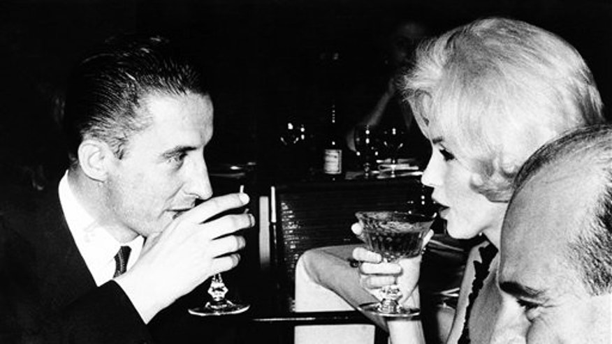 Marilyn Monroe and Jean Pierre Piquet, left, manager of Continental Hilton Hotel, are seen lifting their champagne glasses at  a reception offered to the visiting star, in Mexico City.