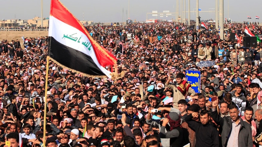 Dec. 28, 2012 - Protesters chant slogans against Iraq's Shiite-led government as they wave national flags during a demonstration in Fallujah, west of Baghdad, Iraq.