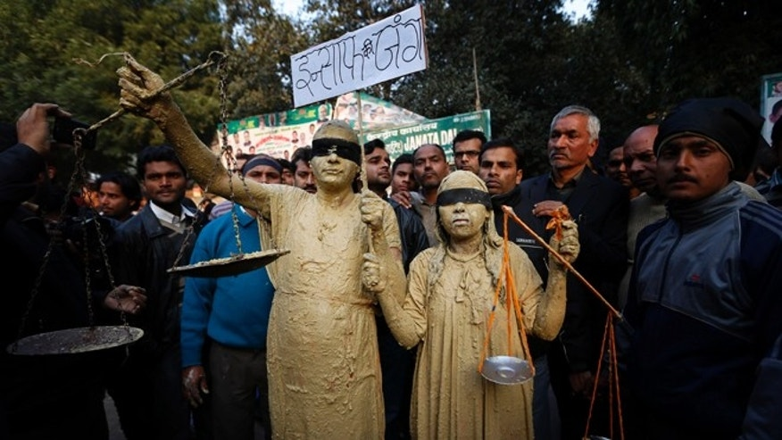 Dec. 29, 2012: A man and a woman dressed as Lady Justice join mourners after news of the death of a gang rape victim in New Delhi, India.