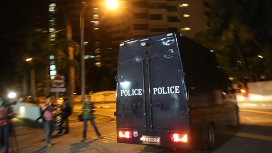 Dec. 29, 2012: A police hearse leaves Mount Elizabeth Hospital in Singapore.