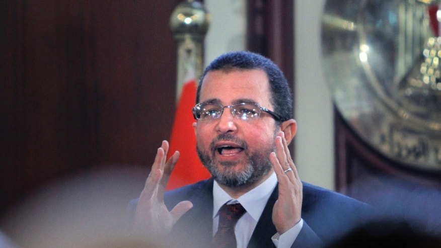 Egyptian Prime Minister Hesham Kandil talks during a press conference in Cairo, Egypt, Sunday, Dec. 30, 2012. Kandil says his country will resume talks in January with the International Monetary Fund over a $4.8 billion loan, after they were suspended during this month's political turmoil over the now-adopted constitution. (AP Photo/Amr Nabil)