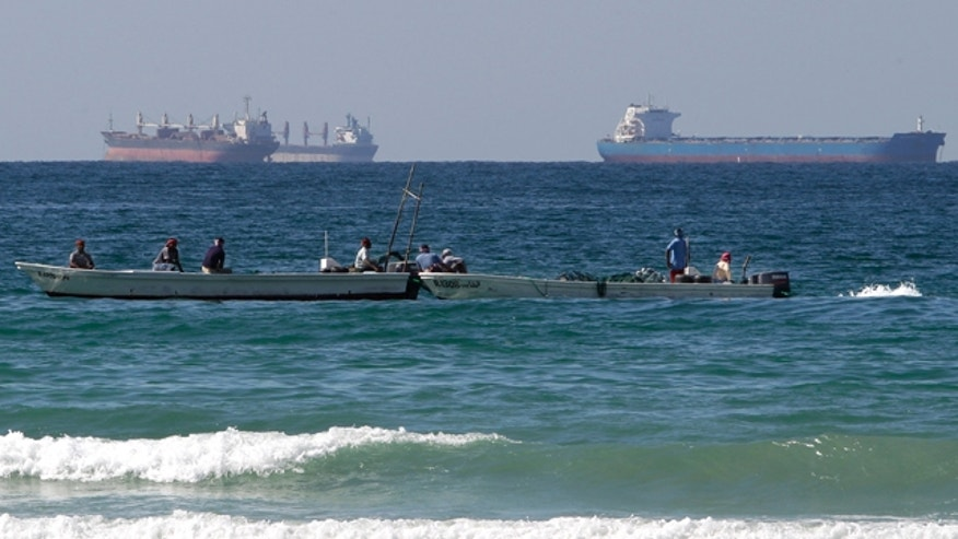 Jan. 19: Fishing boats are seen in front of oil tankers on the Persian Gulf waters, south of the Strait of Hormuz.