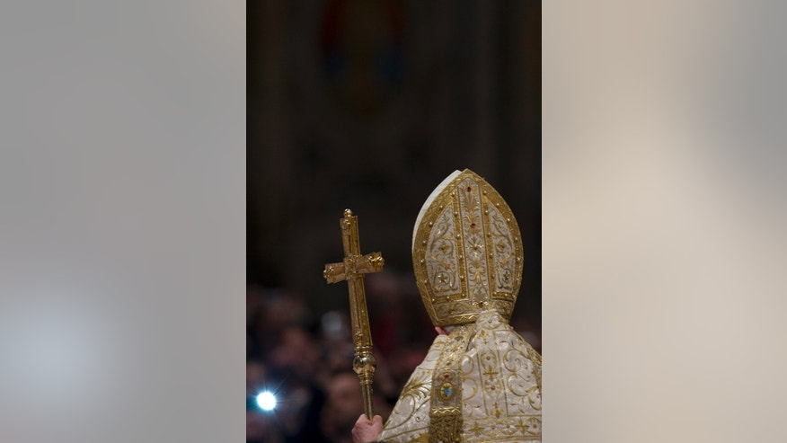 Pope Benedict XVI holds the pastoral staff as he arrives in St. Peter's Basilica to celebrate a New Year's Eve vespers service at the Vatican, Monday, Dec. 31, 2012. (AP Photo/Andrew Medichini)