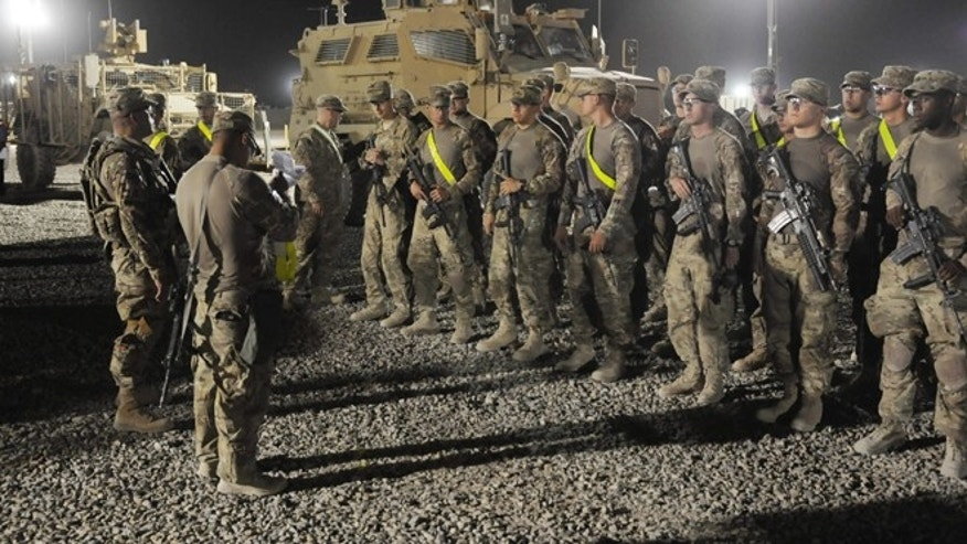 In this Aug. 27, 2012 photo provided by the U.S. Army, U.S. soldiers from the 4th Brigade, 82nd Airborne arrive to turn in their vehicles and equipment as part of the drawdown at the Kandahar Air Field south of Kabul, Afghanistan.