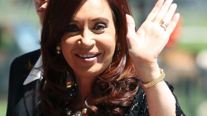 December 7, 2012: Argentina's President Cristina Kirchner waves as she arrives at Itamaraty Palace in Brasilia.