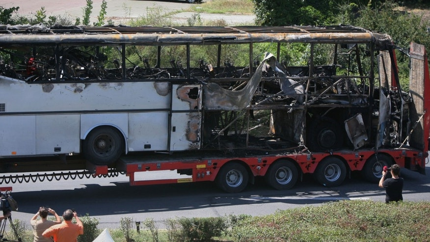 July 19, 2012 in this file photo, a damaged bus is transported out of Burgas airport, Bulgaria, a day after a deadly suicide attack on a bus full of Israeli vacationers.