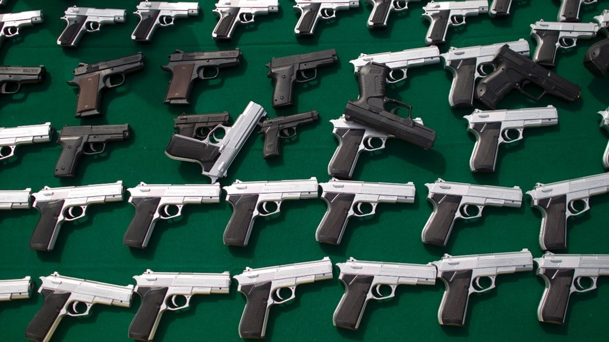 Toy handguns are displayed for the press at a government ceremony in Mexico City, Friday, Jan. 4, 2013. According to city officials, about 7,000 seized toy guns were destroyed at the ceremony, where Mexico City Mayor Miguel Angel Mancera said at least three of every 10 violent crimes in Mexico City are committed with toy weapons. (AP Photo/Alexandre Meneghini)
