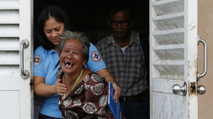 Jan. 4, 2013 -  Caimol, 63, the grandmother of shooting victim Micaela Caimol, 7,  cries after viewing her granddaughter inside a morgue of a private hospital south of Manila, Philippines.