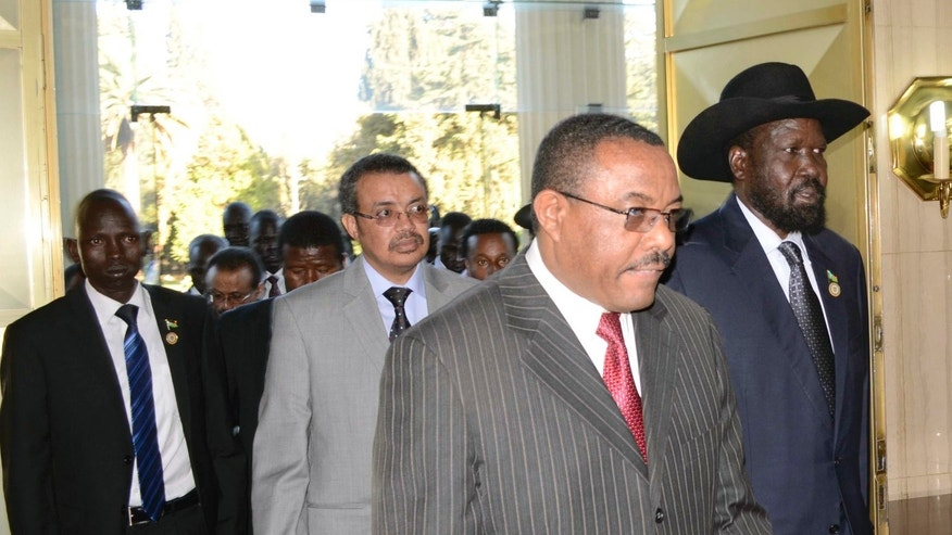 President Salva Kiir, right, of South Sudan arrives at the National Palace  with Prime Minister Hailemariam Dessalegn, left, of Ethiopia during  talks in Addis Ababa, Ethiopia, Friday Jan. 4, 2013.The presidents of Sudan and South Sudan are meeting to try to break through stalled oil agreements.(AP Photo)