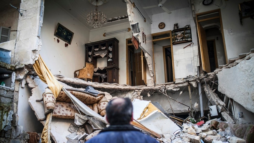 Jan. 3, 2013 - A civilian looks at a destroyed home in Aleppo, Syria.