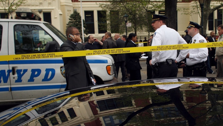 NEW YORK - APRIL 30: Members of the New York Police Department investigate a police involved shooting on April 30, 2009 in the Brooklyn borough of New York. Two people were reportedly shot at the Crown Heights-Utica Avenue station when a male stabbed a police officer in the shoulder with a screwdriver, prompting shots being fired, according to police. The suspect was shot in the leg and transported to Kings County Hospital. Another individual was shot in the chest, according to reports, but by whom was not clear. The person's condition was not immediately available.  (Photo by Spencer Platt/Getty Images)