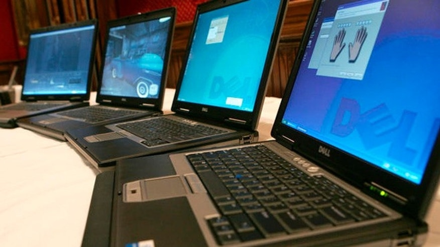 Dell's next generation mobile platforms are shown at a press preview, Tuesday, March 28, 2006, in New York. From left to right are the mobile workstations Dell Precision M90 and Dell Precision M65 and the notebooks Dell Latitude D820 and the Dell Latitude D620.  (AP Photo/Diane Bondareff)