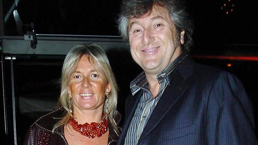 In this photo taken on March 30, 2005 Vittorio Missoni, right, and his wife Maurizia Castiglioni smile in Milan, Italy. The search resumed Saturday, Jan. 5, 2013 for a small plane that has disappeared off the Venezuelan coast with six people aboard, including Vittorio Missoni, a top executive in Italy's Missoni fashion house, officials said.