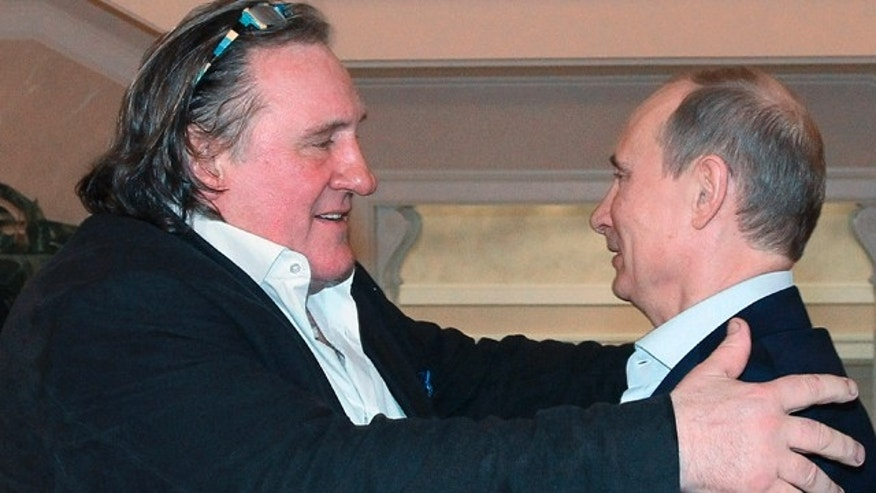 Jan. 5, 2013: French actor Gerard Depardieu, left, greets Russian President Vladimir Putin after his arrival at the president's residence in Sochi.