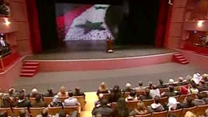 In this image taken from video obtained from Syrian State Television, which has been authenticated based on its contents and other AP reporting, Syrian President Bashar Assad speaks at the Opera House in central Damascus, Syria, Sunday, Jan. 6, 2013.