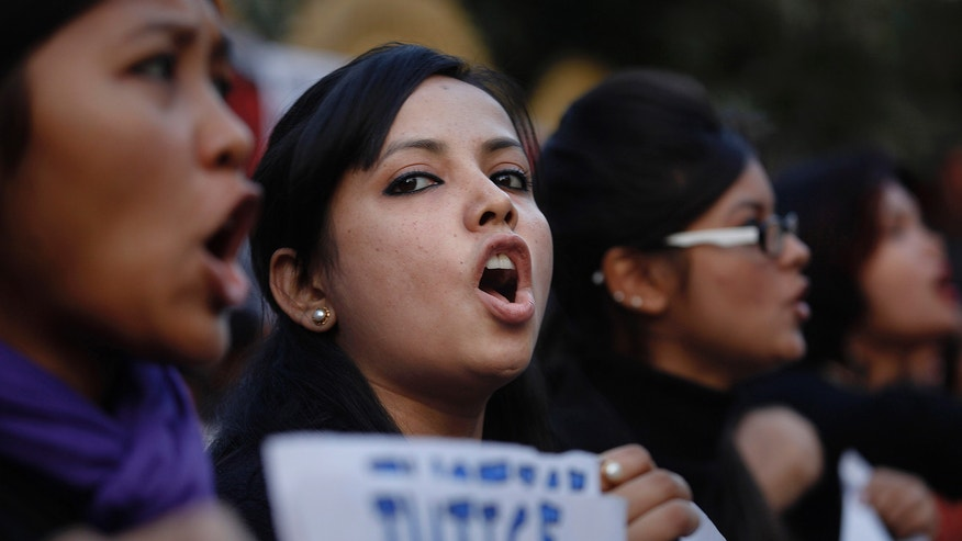Jan. 3, 2012: Students shout slogans during a protest against a leader of the ruling Congress party, who was arrested on accusations he raped a woman in a village in the early hours of the morning, in Gauhati, India.