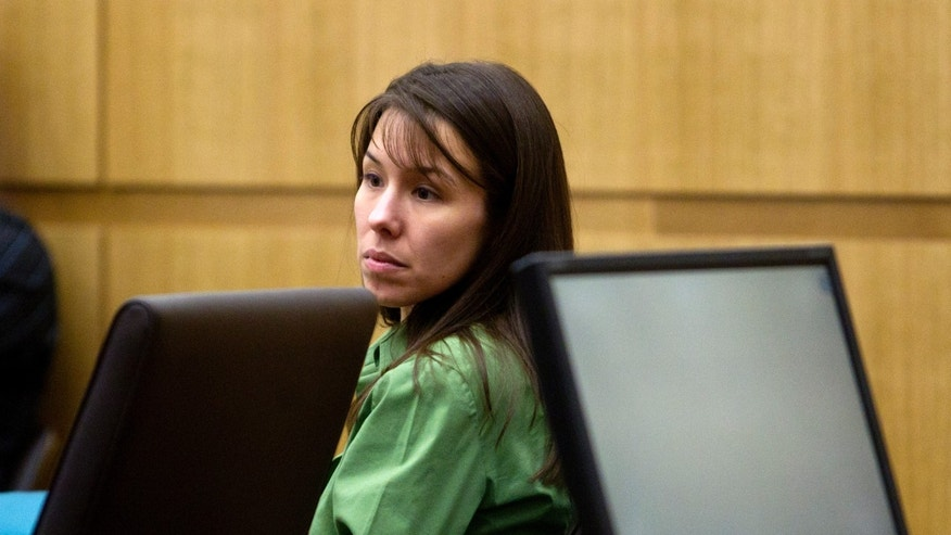 Defendant Jodi Arias listens to prosecutor Juan Martinez  during her trial at Maricopa County Court in Phoenix, Thursday, Jan. 3, 2013. Arias, 32, is charged with killing her motivational speaker ex-boyfriend Travis Alexander, in a jealous rage in Arizona in 2008. Prosecutors said she shot him in the face, stabbed him nearly 30 times and slit his throat during a volatile, jealousy-fueled relationship. (AP Photo/The Arizona Republic, Cheryl Evans)