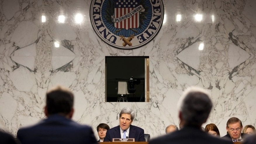 Committee Chairman Sen. John Kerry (D-MA) (C) questions witnesses Deputy Secretary of State William Burns (R) and Deputy Secretary of State for Management and Resources Thomas Nides.