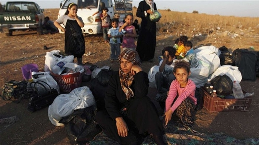 A wave of Syrian refugees, many of them Palestinian, is sparking a regional humanitarian crisis - but Hamas and the Palestinian Authority aren't helping. (AP)
