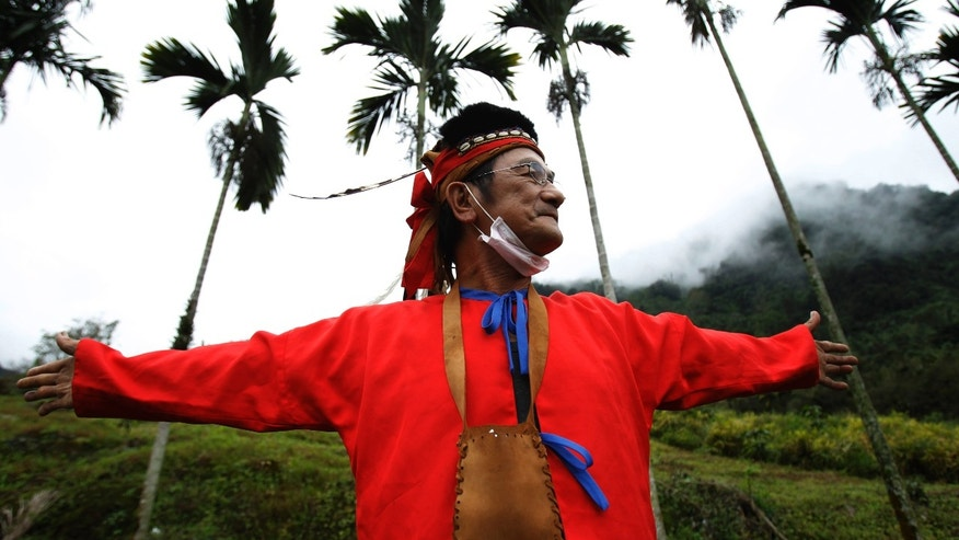 In this photo taken Saturday, Dec. 8, 2012, sixty-year-old Angai Ka'angena talks of the gone-by days when the village was much bigger along the high road above his aboriginal Kanakanvu mountain village of Dakanua, southern Taiwan. In a race against time, a dedicated Taiwanese linguist is trying to save the historically important aboriginal dialect of Kanakanvu, spoken by only 10 people, from extinction. (AP Photo/Wally Santana)