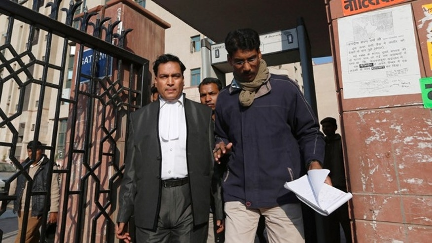 Jan. 10, 2013: Ajay Prakash Singh, left, lawyer for two of the accused, comes out of the Saket district court complex where the accused in a gang rape are to be tried, in New Delhi, India.