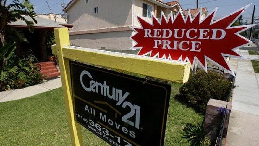 A reduced price is posted on a home for sale in the Los Feliz neighborhood of Los Angeles  Wednesday, June 13, 2007. Home sales in six Southern California counties slowed in May to a 12-year low for the month, with Riverside and San Bernardino counties posting the biggest annual declines, according to a report released by DataQuick Information Systems. (AP Photo/Damian Dovarganes)