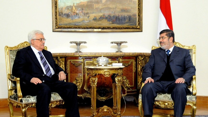 In this image released by the Egyptian Presidency, Egyptian President Mohammed Morsi, right, meets with Palestinian President Mahmoud Abbas at the Presidential Palace in Cairo, Egypt, Wednesday, Jan. 9, 2013. (AP Photo/Egyptian Presidency)
