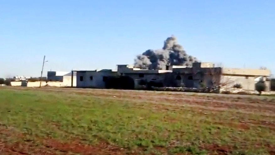 In this image taken from video obtained from the Shaam News Network, which has been authenticated based on its contents and other AP reporting, smoke rises due to heavy shelling in Taftanaz, Idlib province, northern Syria, on Thursday, Jan. 10, 2013. (AP Photo/Shaam News Network via AP video)