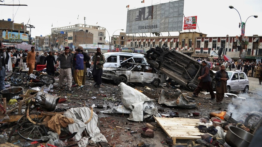 Jan. 10, 2013 - Pakistani police officers and local residents gather at the site of a bomb blast that targeted paramilitary soldiers in a commercial area in Quetta, Pakistan.