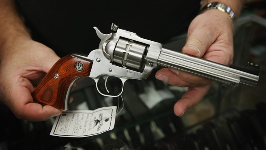 TINLEY PARK, IL - OCTOBER 18:  Fred Lutger, owner of Freddie Bear Sports, shows a Ruger Single Ten .22 caliber revolver being offered for sale at his store on October 18, 2012 in Tinley Park, Illinois.  Facing a $267.5 million fiscal 2013 budget gap, Cook County, which includes the City of Chicago and suburbs, has proposed a tax of 5 cents per bullet and $25 on each firearm sold at gun and sporting goods stores in the county. Lutger, who has owned Freddie Bear Sports for 35 years, is concerned with the impact the tax will have on his store which is located about 2 miles inside the Cook County line.  (Photo by Scott Olson/Getty Images)