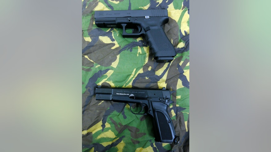 This Jan. 9, 2013 photo shows a Glock 17 Gen 4 pistol, top, and a Browning pistol that is being replaced, during a media opportunity at the Royal Artillery Barracks in London, Wednesday, Jan. 9, 2013. The defense ministry has signed a 9 million pound ($13.6 million) contract to provide the Armed Forces with more than 25,000 new Glock sidearms. (AP Photo/Kirsty Wigglesworth)