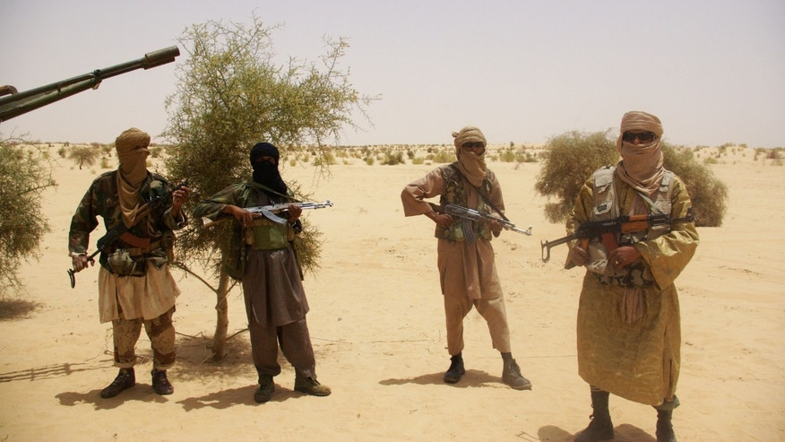 April 24, 2012 - FILE photo: Fighters from Islamist group Ansar Dine stand guard during a hostage handover in the desert outside Timbuktu, Mali.
