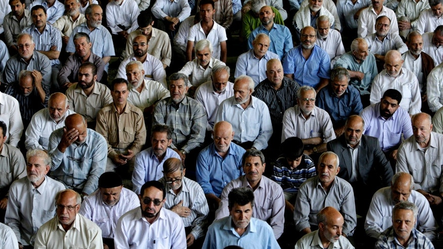 FILE - In this Friday, July 27, 2012 file photo, Iranian worshippers listen to the Friday prayer's sermon, at the Tehran University campus, in Tehran, Iran. Elections to pick Iran's next president are still five months away, but that's not too early for some warning shots by the country's leadership. The message to anyone questioning the openness of the June vote: Keep quiet. (AP Photo/Vahid Salemi, File)