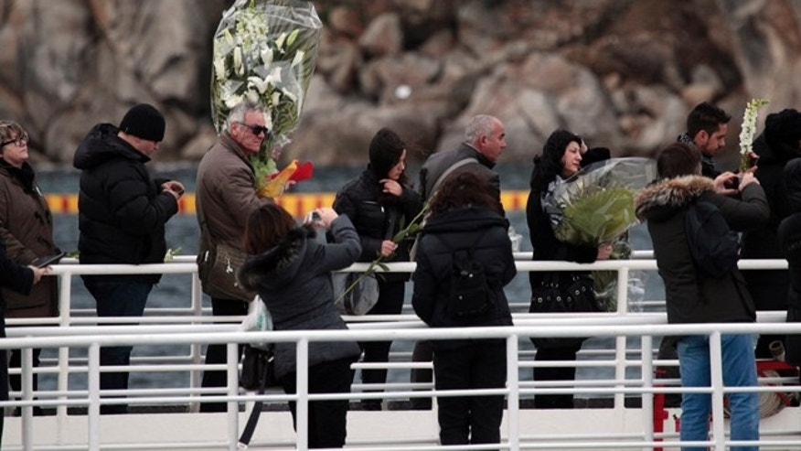 Jan. 13, 2013: Relatives of the 32 victims of the Costa Concordia shipwreck aboard a ferry approach the ship off the Tuscan Island of Isola del Giglio, Italy.