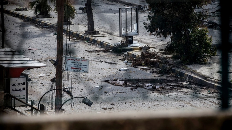 Jan. 13, 2013 - Two dead bodies lie on a street in the Saif al-Dawlah neighborhood of Aleppo, Syria.