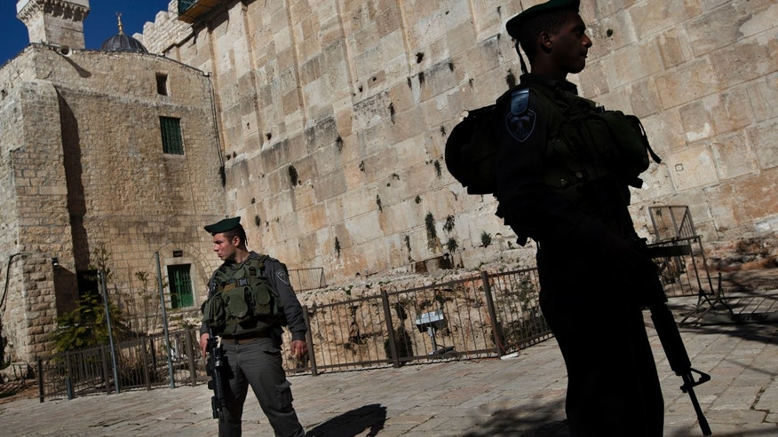 Jan. 14, 2013 - Israeli border police stand guard at the site known to Jews as the Tomb of the Patriarchs, and to Muslims as the Ibrahimi Mosque, in the West Bank city of Hebron.